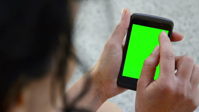 Business woman using a Smartphone Touchscreen CHROMA KEY- Close-up video