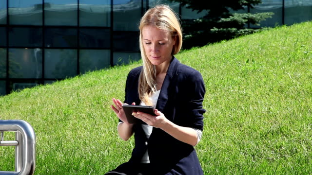 Business woman using a tablet computer video