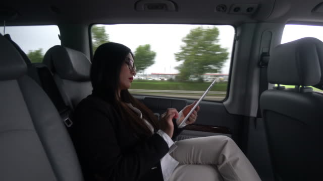 Business woman using digital tablet and smartphone video