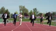Business woman winning a race video