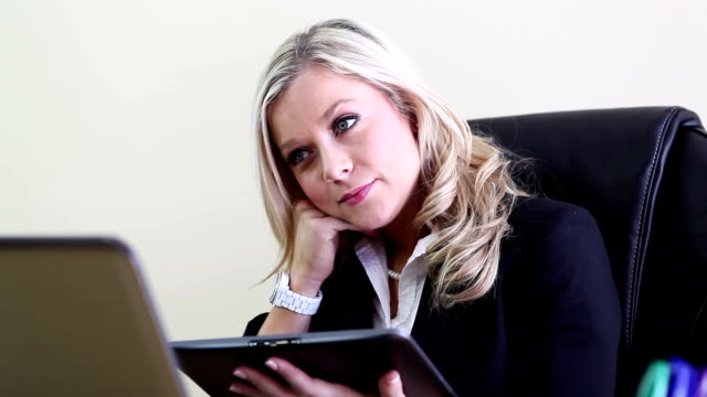 Business woman with Wireless Tablet video
