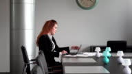 Business woman working in the office laptop video