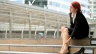 Business women massaging tired legs video