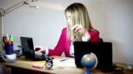 Business women work in office until late video