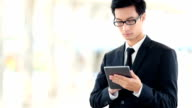 Business young man of asian origin in a black suit. video