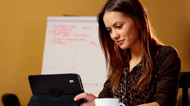 Business young woman reads financial news in computer device video