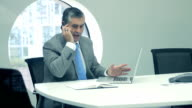 Business_Executive_Working_in_Office video