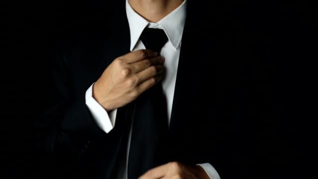 Businessman Adjust Necktie his Suit video