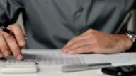 Businessman analyzes financial graphs video