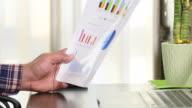 Businessman analyzing business report video
