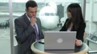 Businessman and Businesswoman have meeting at airport video