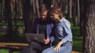 Businessman and businesswoman meet at the open air discussing project video