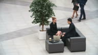 Businessman and Businesswoman Talking in Lobby video