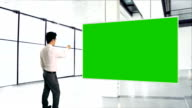 Businessman and greenscreen video