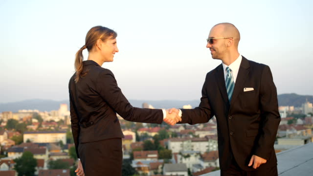 CLOSE UP: Businessman and woman from corporate company conclude an agreement video