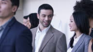 Businessman and woman in crowd video