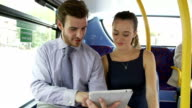 Businessman And Woman Using Digital Tablet On Bus video