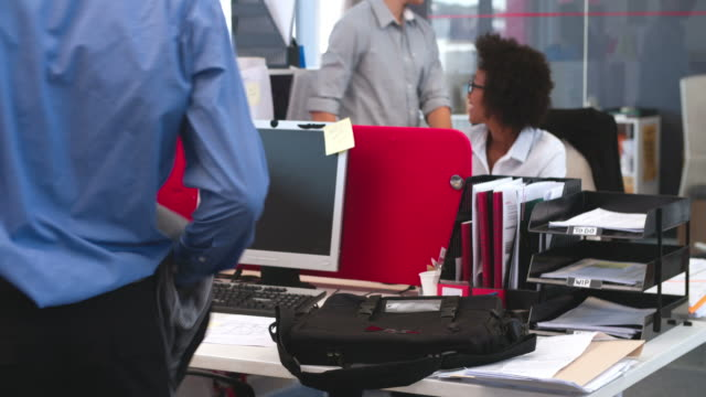 Businessman Arriving In Office And Sitting At Desk video