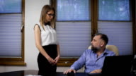 businessman assistant can not cope with the orders. A respectable man does reprimand his subordinate video
