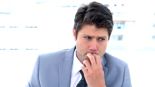 Businessman biting his nails video