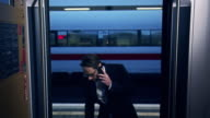 Businessman boarding train video