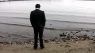 Businessman by the lake. video