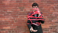Businessman caught in red tape. video