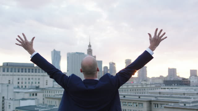 Businessman celebration sucess on roof. video