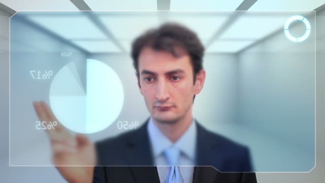 Businessman checking data on touch screen video