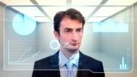Businessman checking data video