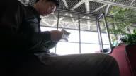 Businessman checking passport at airport video