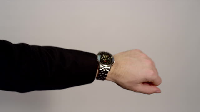 CLOSE-UP: Businessman checking the time on his watch video