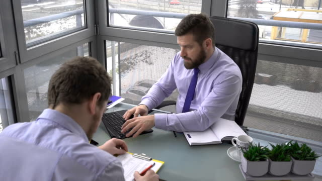 Businessman close laptop, finish working, relax, resting, in office video