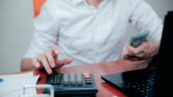 Businessman counting dollars and checking financial results video