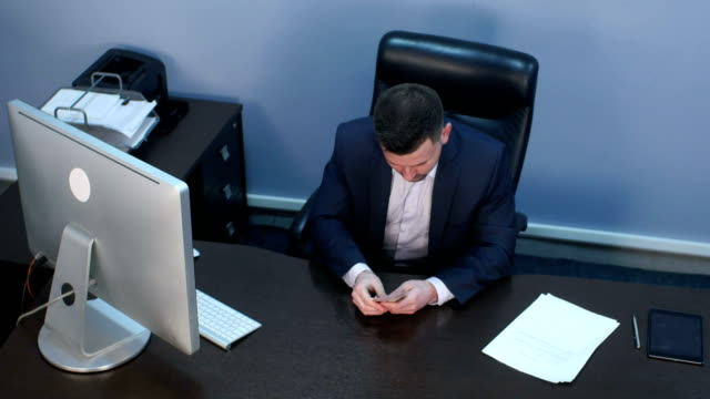 Businessman counting money dollars at the office video