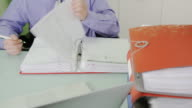 HD TIME-LAPSE: Businessman Doing Paperwork video