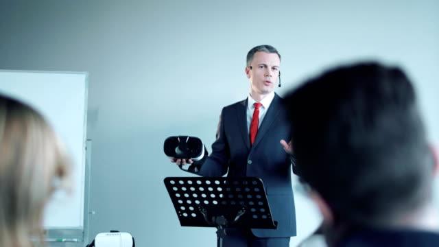 Businessman doing presentation of vr helmet video