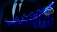 Businessman drawing an ascending financial chart. Touchscreen. Business success. Blue-white. video