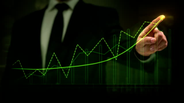 Businessman drawing an ascending financial chart. Touchscreen. Business success. Green-Red. video