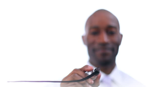 Businessman drawing arrow on glass video