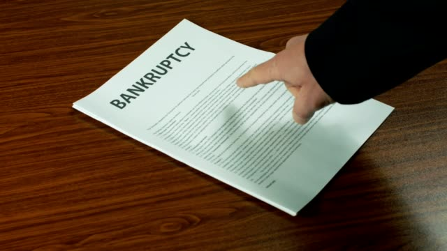 Businessman Dressed In A Suit Showing A Bankruptcy Documentation - Close Up. video