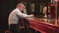 HD DOLLY: Businessman Drinking In Despair video