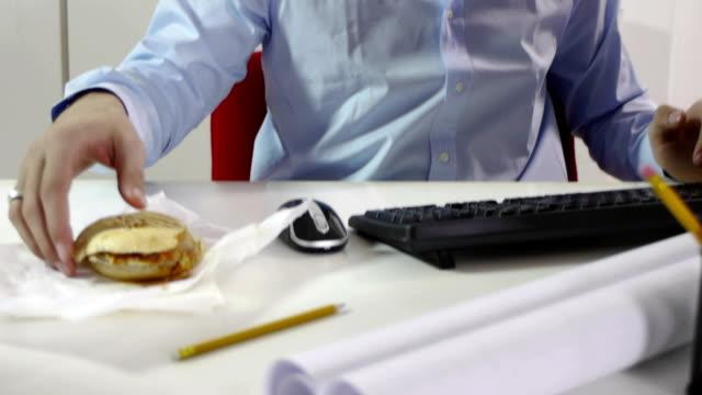 Businessman eating junk food video