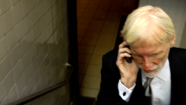 Businessman Emerges from Subway Station video