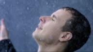 Businessman Enjoying The Heavy Rain video