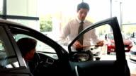 Businessman explaining the car details video