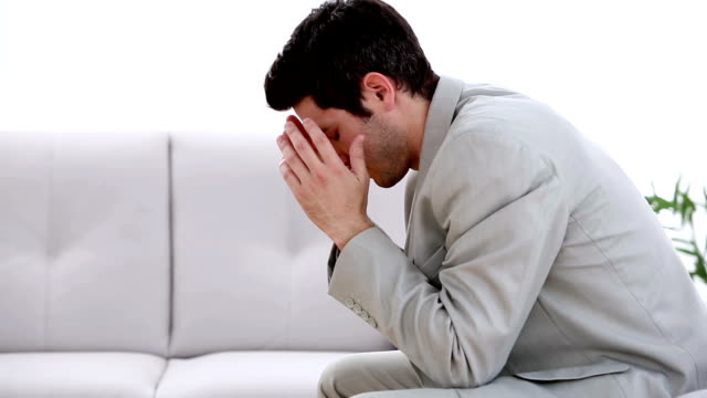 Businessman feeling the sting of defeat video