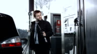 HD DOLLY: Businessman Filling Up A Gas Tank video
