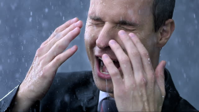 Businessman Get Drenched In The Rain (Super Slow Motion) video