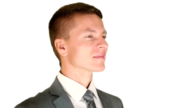 Businessman getting in focus, turns and smile video